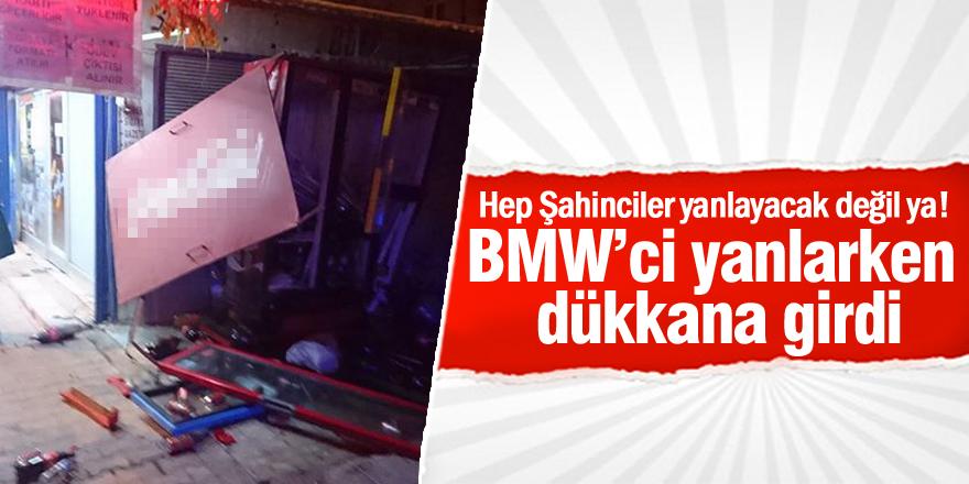 BMW'ci yanlarken dükkana girdi