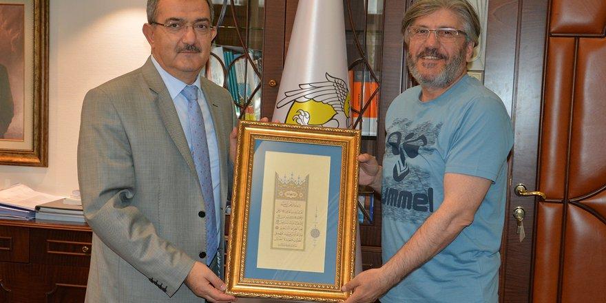 Yeni teknik ekip Rektör Şahin'i  ziyaret etti