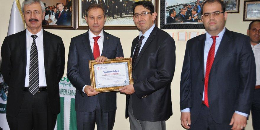 Vergi Dairesi'nden Karabacak'a plaket
