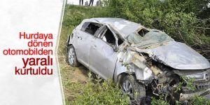 Hurdaya dönen otomobilden yaralı kurtuldu