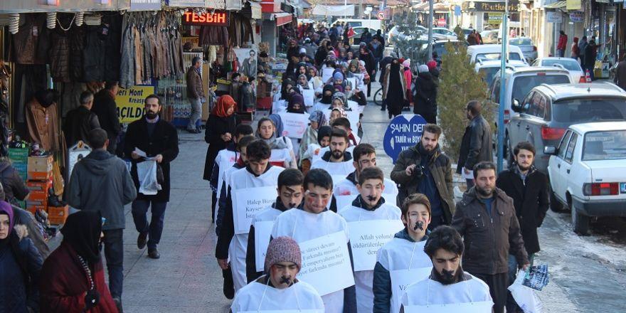 Terör saldırılarına kefenli protesto